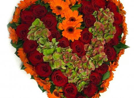 Rouwarrangement 'Autumn' (hartvorm)